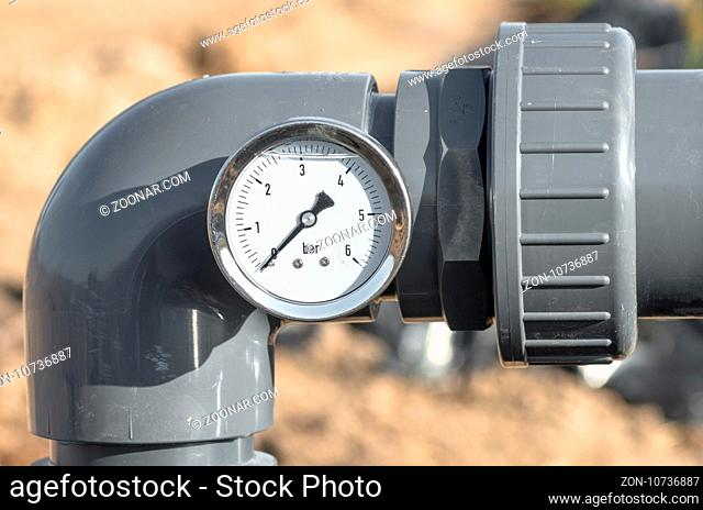 Close up of pressure gauge and pipes