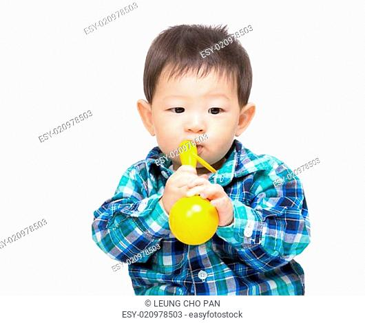 Happy baby boy with yellow toy