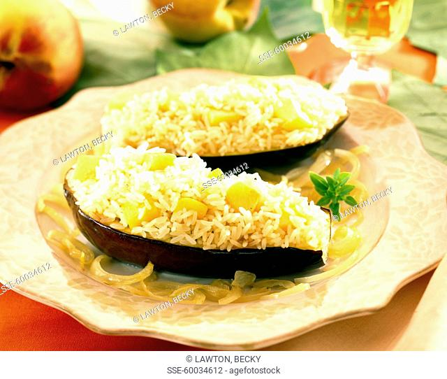 Eggplants stuffed with white rice and diced peaches