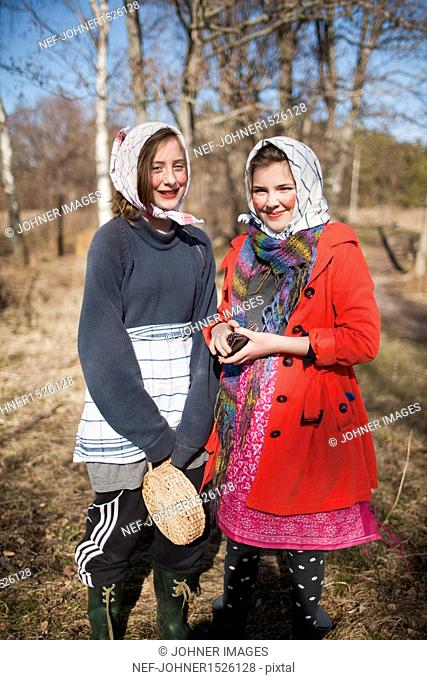 Portrait of two girls dressed up as Easter witches