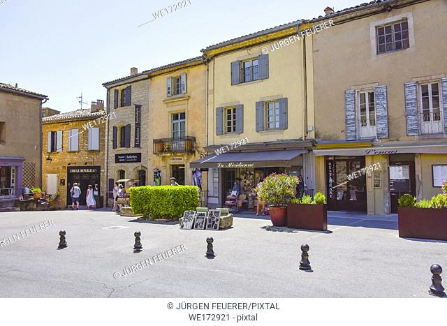 square with colourful houses of village Gordes, Provence, France, member of Les Plus Beaux Villages de France, Most Beautiful Villages of France