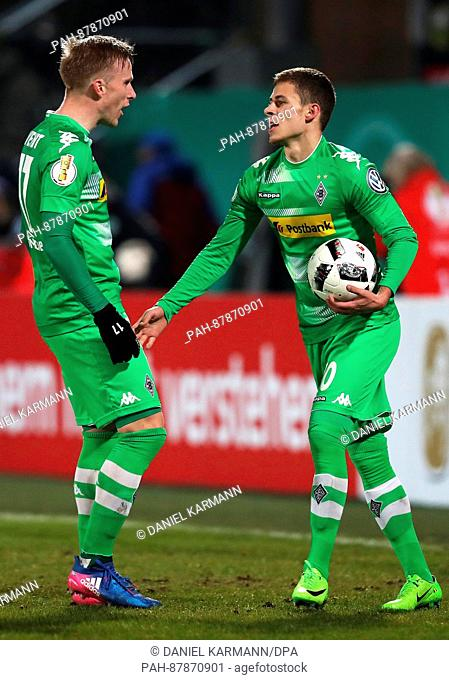 Galdbach's Thorgan Hazard (R) cheers over his 0-2 score with his teammate Oscar Wendt during the German DFB Cup match between SpVgg Greuther Fuerth and Borussia...