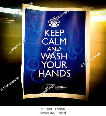 'Keep calm and wash your hands' sign in public restroom