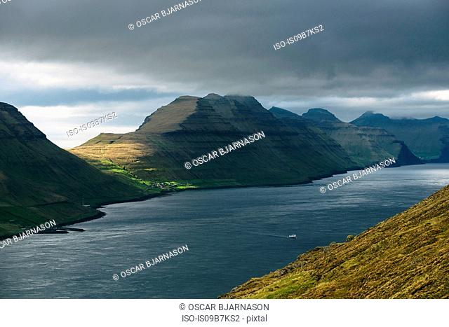 View towards the island of Kalsoy and the village Sydradalur, Faroe Islands, Denmark