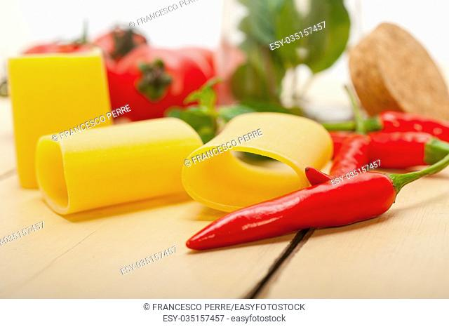 Italian pasta paccheri or schiaffoni with tomato mint and chili pepper ingredients