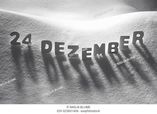 White Letters Building German Text 24 Dezember Means 24th December On White Snow. Snowy Landscape Or Scenery. Christmas Card For Seasons Greetings Or Usable As...