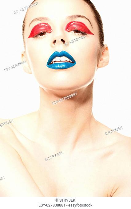 High fashion look.glamor closeup beauty portrait of beautiful sensual Caucasian young woman model with blue lips and red eye liner