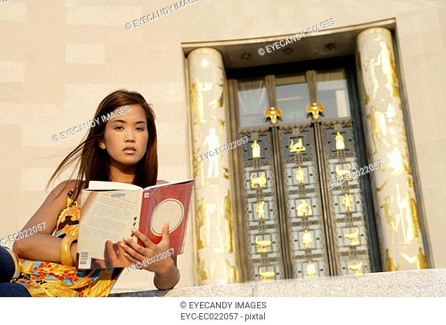 Ethnic woman reading a book