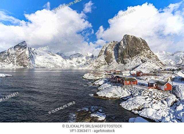 Hamnoy village covered in snow, with Festheltinden and Olstinden peaks in the background. Moskenes municipality, Nordland county, Northern Norway, Norway