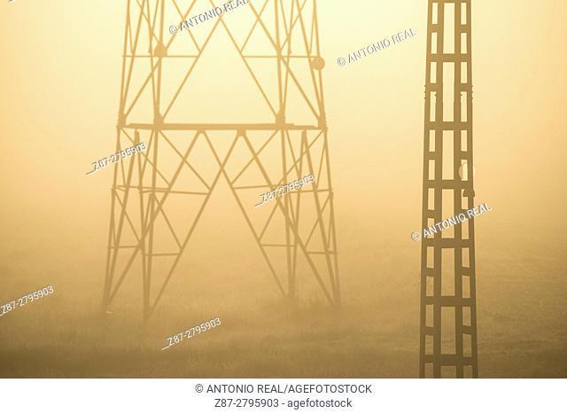 Pylon in fog, Almansa, Albacete province, Castilla-La Mancha, Spain