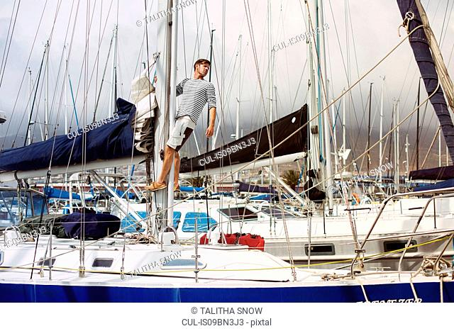 Man on sailboat, Cape Town, Western Cape, South Africa