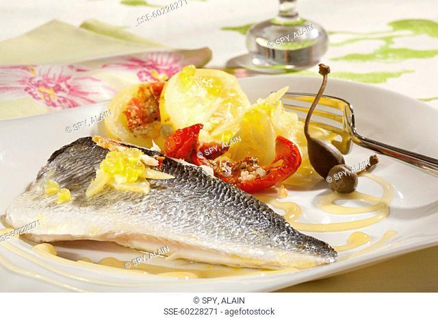 Lake Geneva whitefish with honey,sun-dried tomato,lemon balls and capers