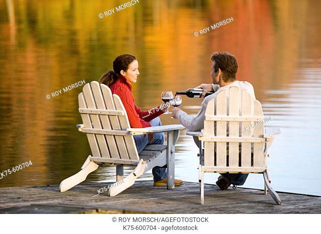 caucasians, age 30's to 40's, lake, dock, wine, adirondack chairs, autumn, reflection