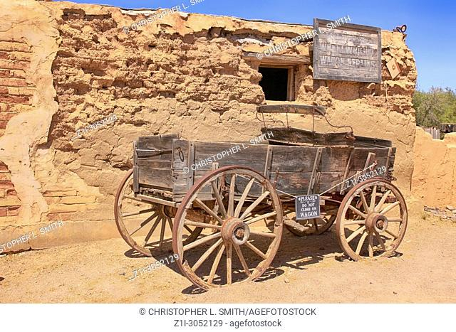 Old wooden wagon outside a building at the Old Tucson Film Studios amusement park in Arizona