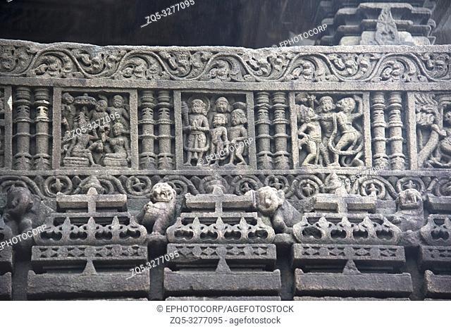 Stone carvings on Gondeshwar Temple wall, Sinnar, Maharashtra, India