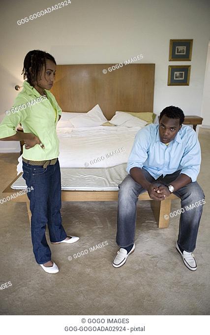 Couple talking in bedroom
