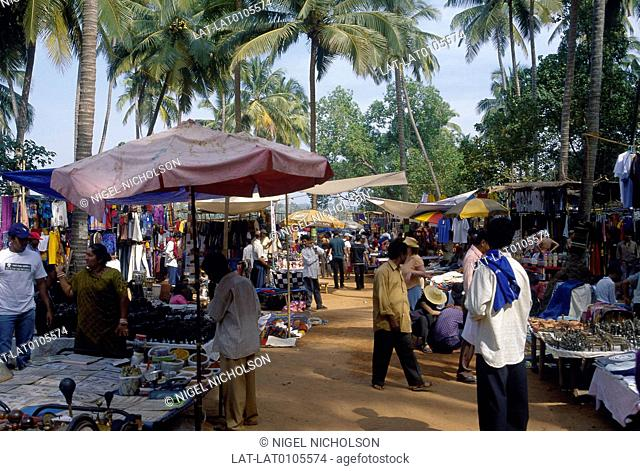 Market place. Stalls,arts and crafts. Clothes. People