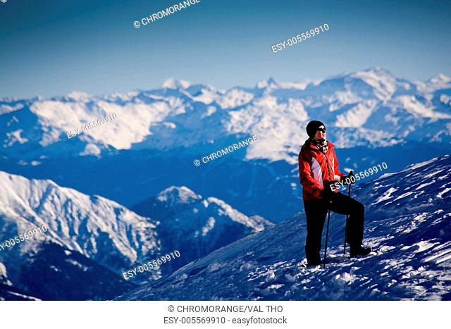 A woman hiking in the mountains Winter scene