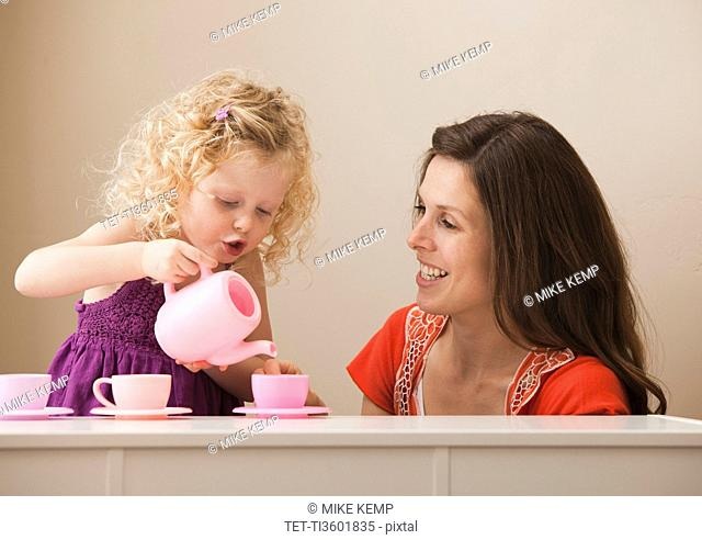 USA, Utah, Lehi, mother and daughter 2-30 having tea