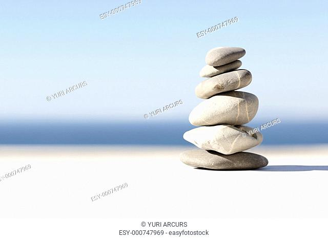 Stack of balanced rocks isolated over a background