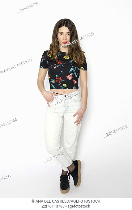 Studio shot of young beautiful woman in jeans white background. Full body