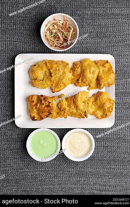 Chicken kabab, marinated with a range of spices and shallow fried