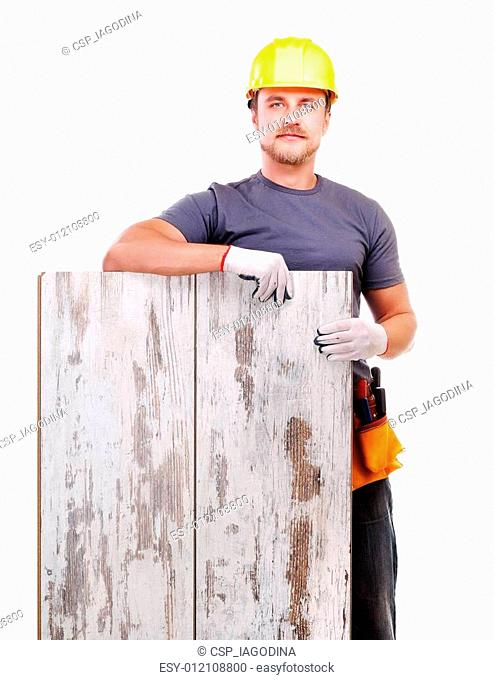 Carpenter holding the floor panel