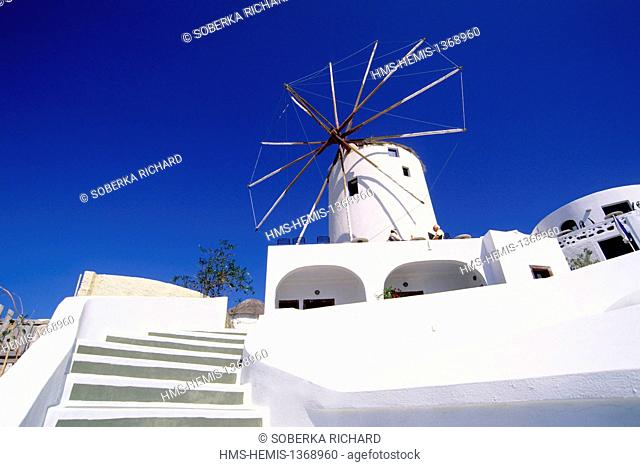 Greece, Cyclades, Aegean Sea, Santorini, Ia, white windmill silhouetted against the blue sky