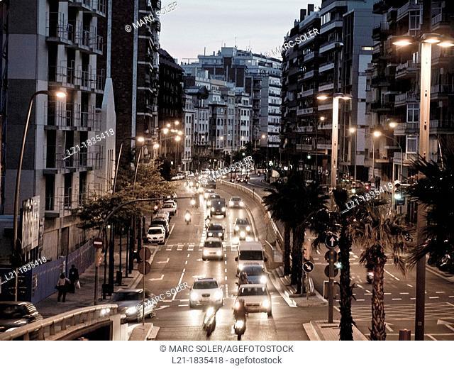 Traffic jam. Cars, trucks and motorcycles at nightfall, night. Travessera de Dalt, Gràcia quarter, Barcelona, Catalonia, Spain