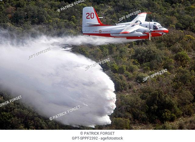 FIRECAT TRACKER DROPPING THE CONTENTS OF ITS WATER HOLD, BOUCHES-DU-RHONE 13