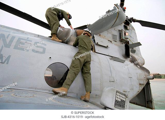 Crew of a US Marine Corps CH-46 Sea Knight Helicopter Prepare the Helicopter for a Mission at the Al Taqaddum Air Base in Al Anbar Province of Iraq