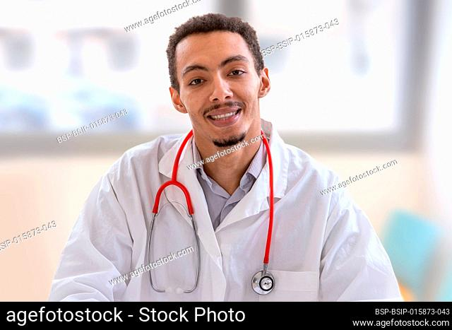 Young Confident African American Hispanic Male Doctor