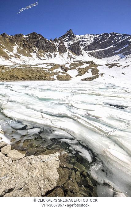 The snow begins to melt due to the spring thaw at Laj dal Teo Poschiavo Valley Canton of Graubunden Switzerland