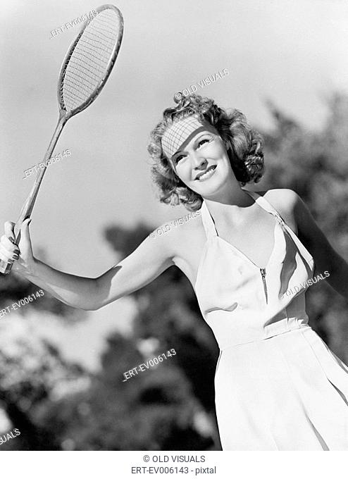 Young woman with a badminton racket All persons depicted are not longer living and no estate exists Supplier warranties that there will be no model release...