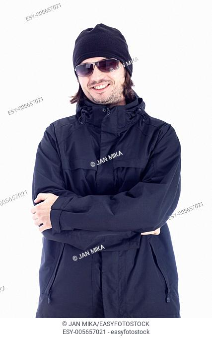 Ecstatic man in winter clothes and sunglasses, isolated on white background