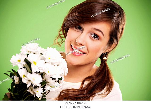 Attractive young woman with white daisies, Debica, Poland
