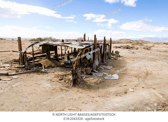 USA, California, Salton Sea, Bombay Beach. Skeletal remains of long ago abandoned camping trainer on the beach of former seaside resort town