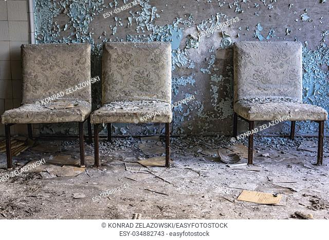 Chairs on a corridor in Hospital No. 126 of Pripyat ghost city, Chernobyl Nuclear Power Plant Zone of Alienation in Ukraine