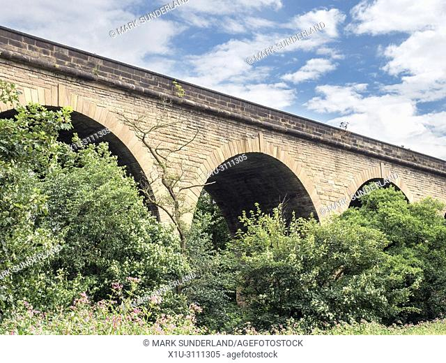 Railway viaduct on the disused part of the old Leeds and Thirsk Railway in the Crimple Valley Harrogate North Yorkshire England
