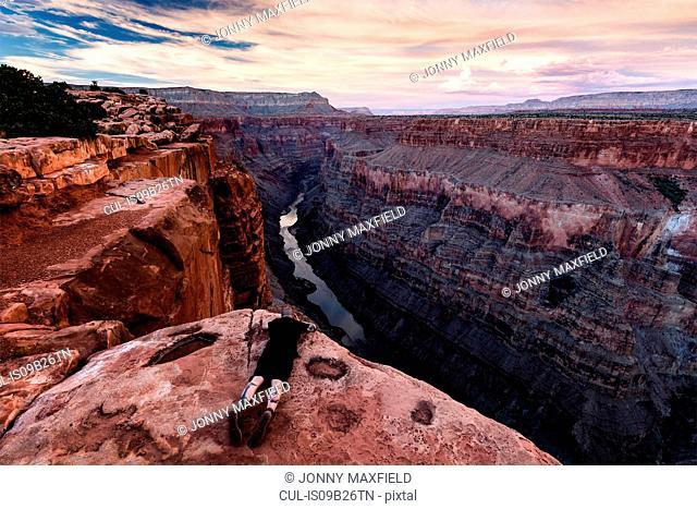 Man lying on rock, looking at view, Torroweap Overlook, Grand Canyon, Torroweap, Arizona, USA