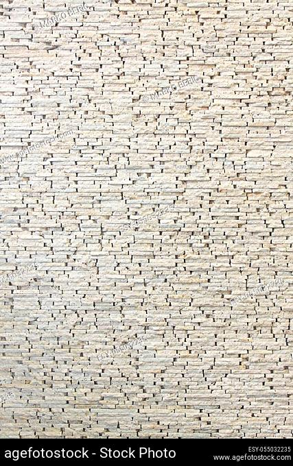 White wall made from small marble tiles
