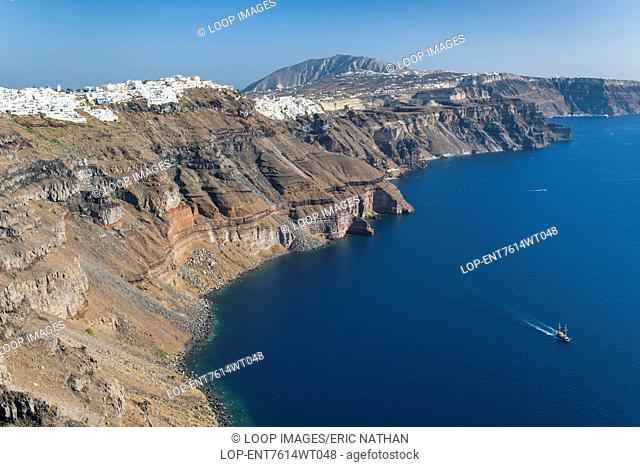 View of the coastline and houses of Fira and Firostefani on the Greek island of Santorini