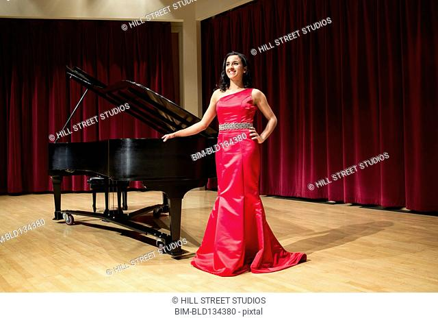 Middle Eastern woman standing at piano