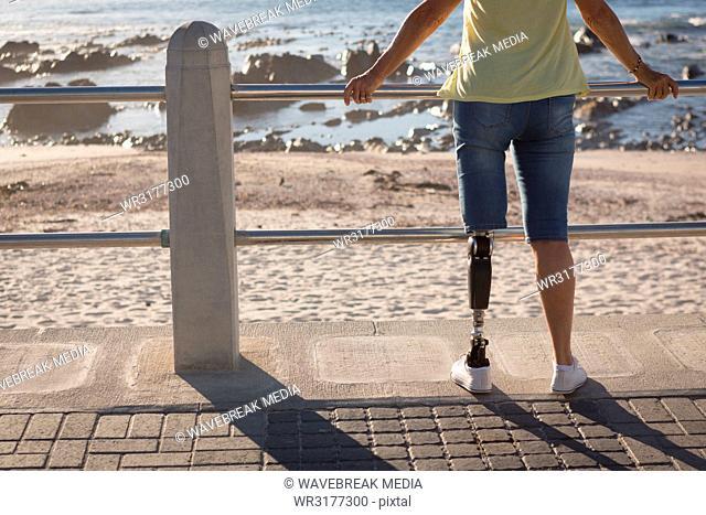 Disabled woman standing near beach