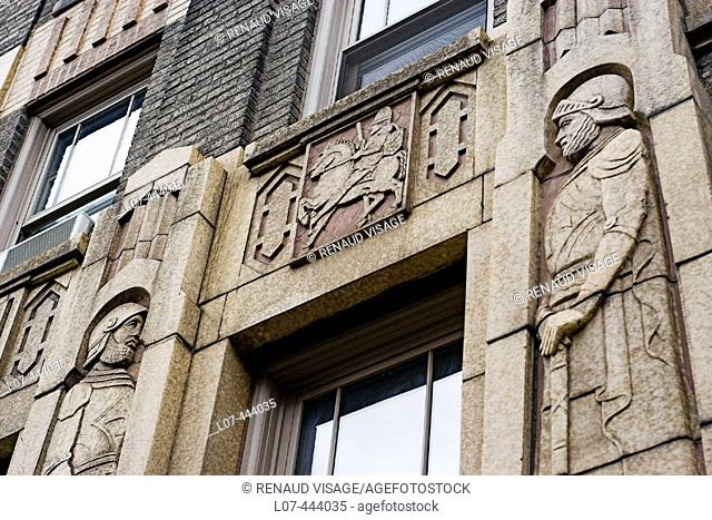 Entrance to apartment building decorated with knights. New York City. New York. United States