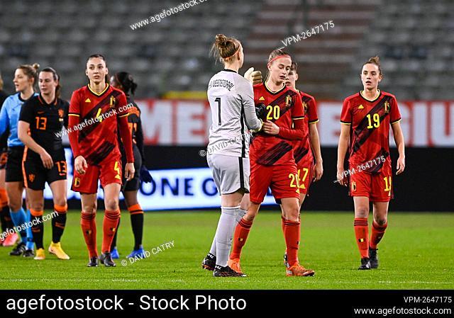 Netherlands' goalkeeper Sari van Veenendaal and Belgium's Julie Biesmans greets after a friendly soccer game between Belgium's national team the Red Flames and...