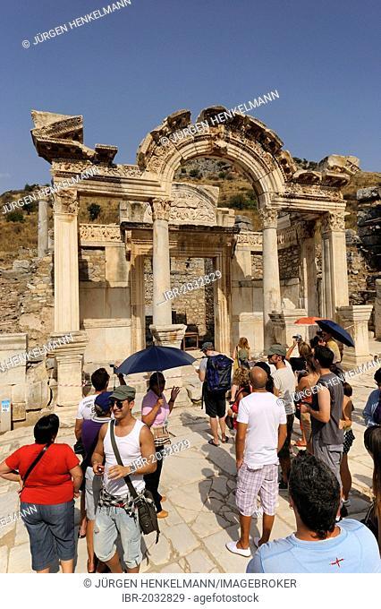 Hadrian's Temple on Curetes Street with tourist group, excavations, ruins at Ephesus, Efes, World Heritage Site, Selcuk, Lycia, Southwest Turkey, West Coast