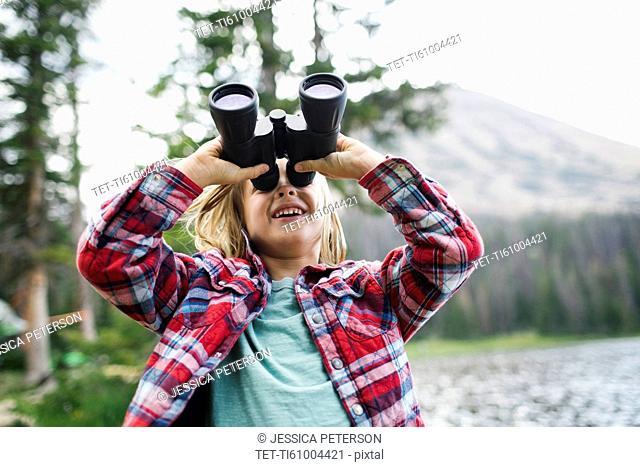 USA, Utah, Midway, Portrait of boy (6-7) looking through binoculars