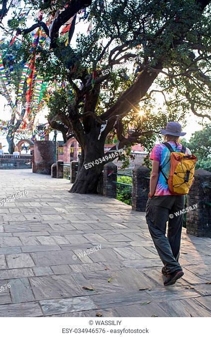 A man near the Buddhist stupa - Tourist in the Nepal