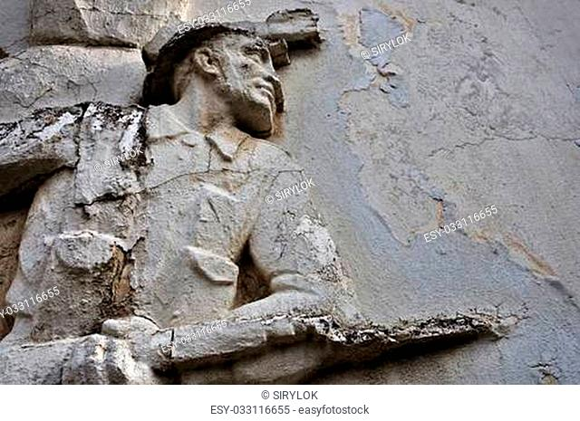 ATHENS - FEBRUARY 3: Entablature of soldier with broken bayonet on weathered wall exterior at the abandoned house of sculptor Nikolaos Pavlopoulos in Athens...